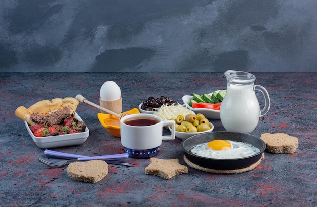 Rich breakfast table with variety of foods.