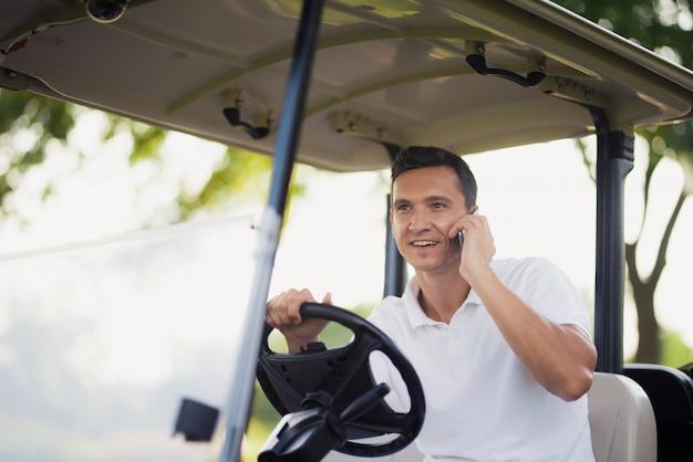 Rich happy businessman in luxury golf car.
