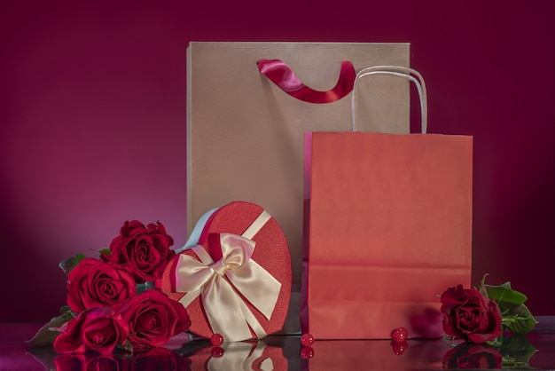 Rich red roses large craft shopping bag heartshaped box lovers gifts