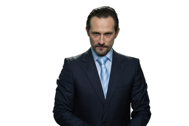 Rich well-dressed businessman. portrait of serious handsome boss isolated on white wall.