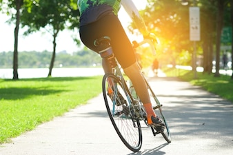 Ride on bike on the road in the city park. Sport and active life concept in the summer time