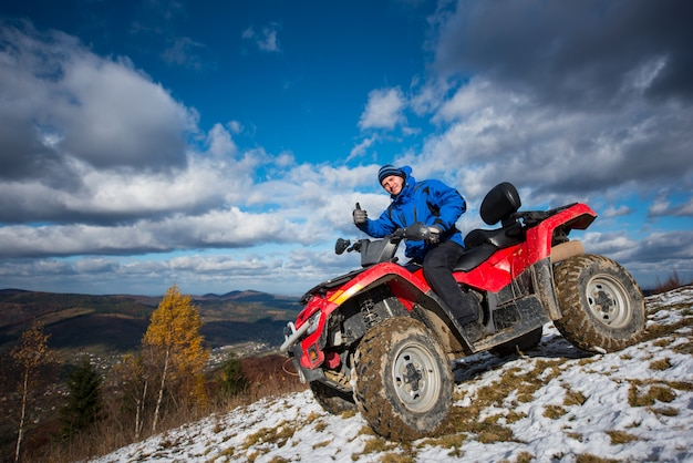 Rider driving on atv off-road vehicle