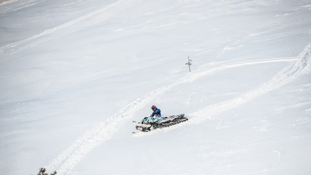 Rider on the snowmobile in the mountains