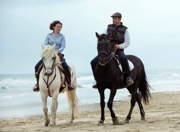 Riders and horses at the beach