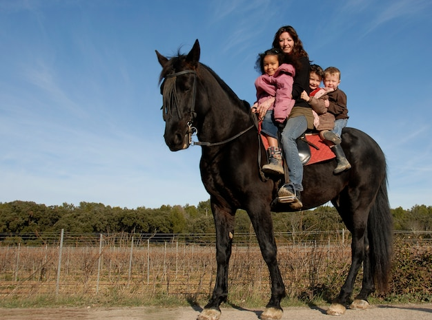 Riding family on a horse