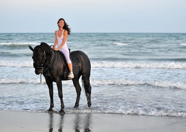 Riding girl on a beach