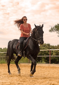 Riding girl and stallion