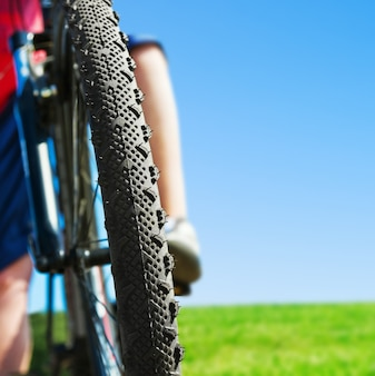 Riding mountain bike and blue sky background