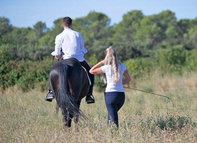 Riding teenager and horse