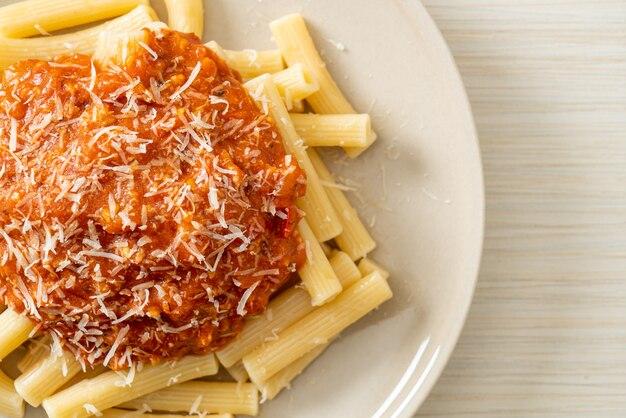 Rigatoni pasta with pork bolognese sauce - italian food style