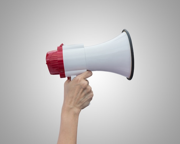 Right hand holding white megaphone isolated on grey background. saved with clipping path
