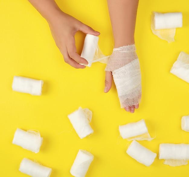 Right hand wrapped with white gauze bandage