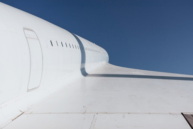 The right wing of white airplane on the open air