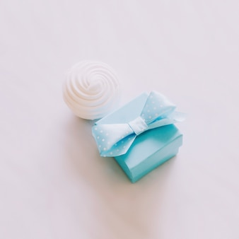 Ring box with zephyr on white background. marriage proposal. love, romance, valentines day concept. flat lay, copy space
