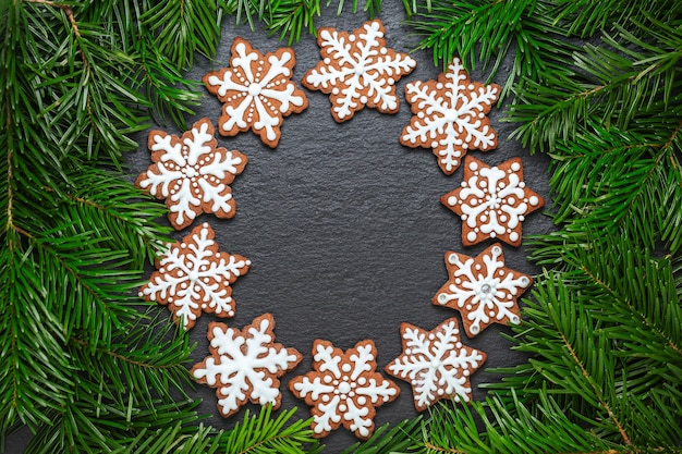 Ring of gingerbread cookies on the slate table