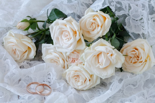 The rings on the flowers on a white fabric, wedding details