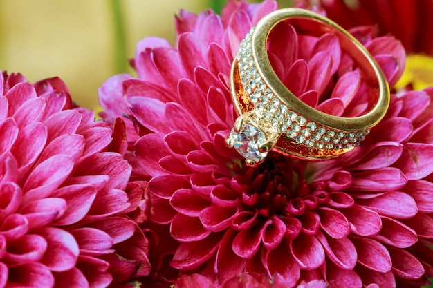 Rings nestled in pink flowers