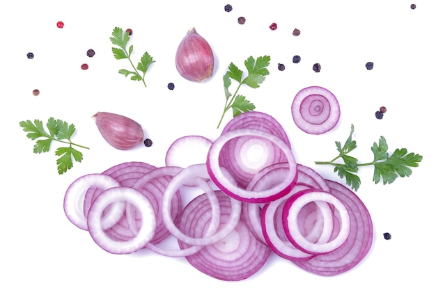 Rings of sliced red onions with herbs and spices on a white isolated background. vegetables. top view