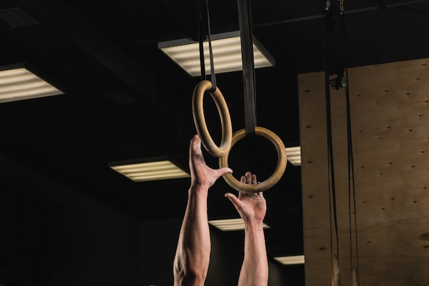 Rings suspended on straps on crossfit gym