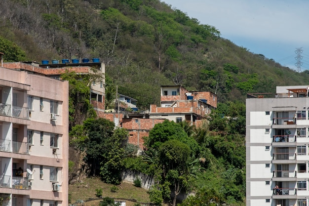 Rio, brazil - september 24, 2021: urban area with slums, simple buildings usually built on the hillsides of the city