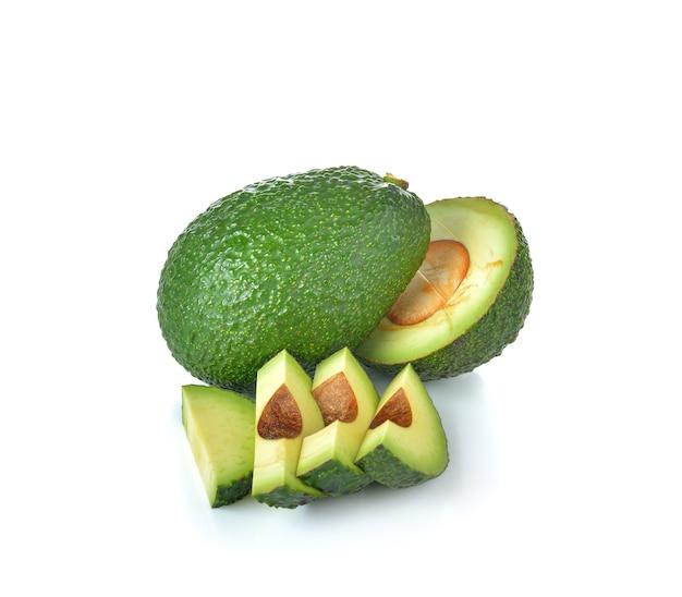 Спелый авокадо на белой стене