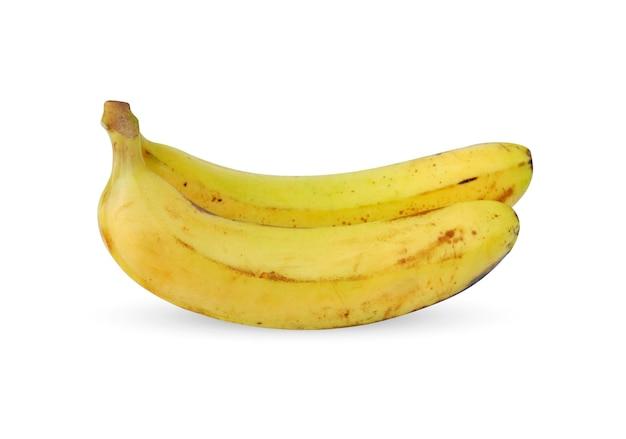 Спелый банан с темными пятнами на белом фоне belakang