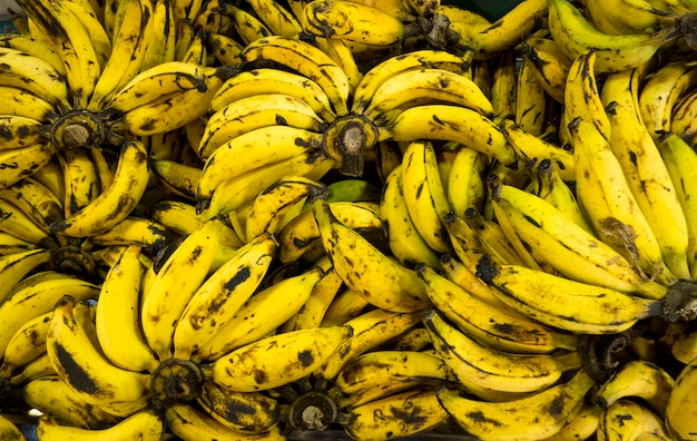 Over ripe bananas background in market