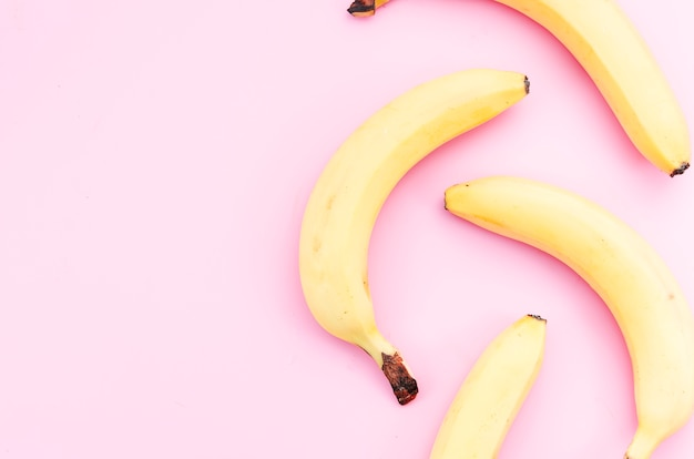 Ripe bananas scattered on table