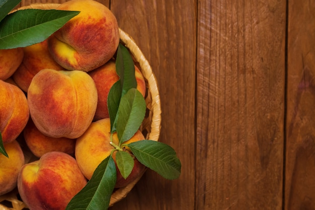 Ripe and beautiful peaches in a basket