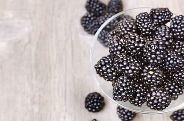 Ripe blackberry in glass bowl