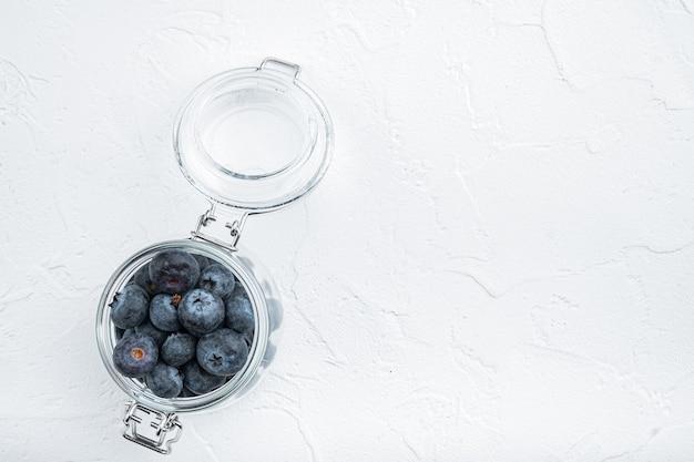 Ripe blueberry in glass jar, flat lay,.