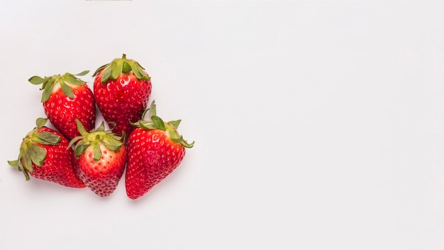 Ripe bright strawberries on white background