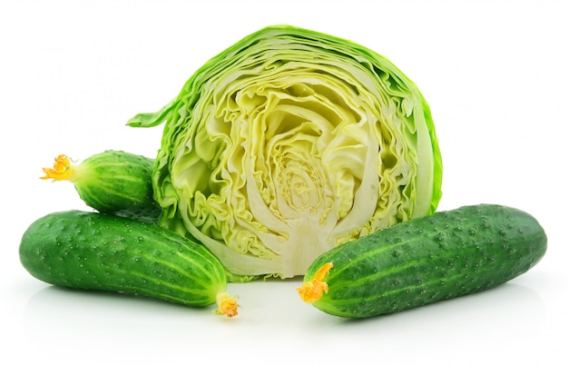 Ripe cabbage and cucumbers isolated on white