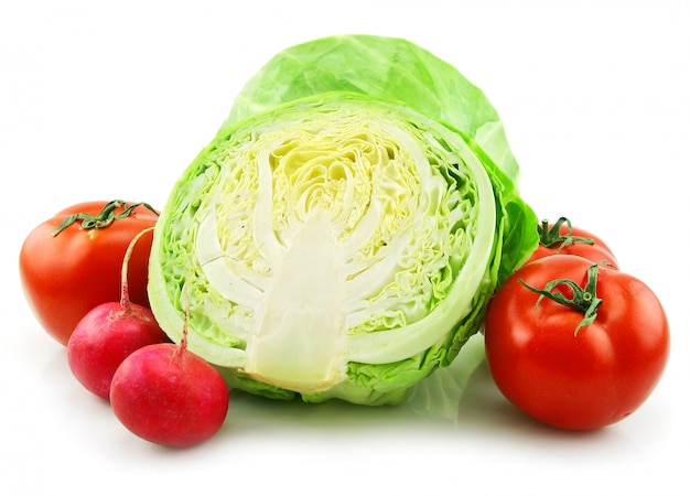 Ripe cabbage, radishes and tomatoes isolated on white background