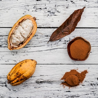 Ripe cocoa pods setup on rustic wooden background.
