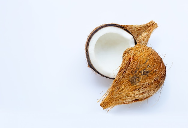 Ripe coconut on white.