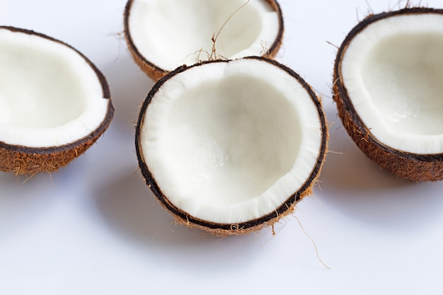 Ripe coconuts on white. top view of tropical fruit.