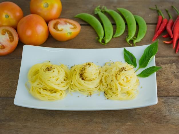 Ripe cooked pasta spaghetti in white plate