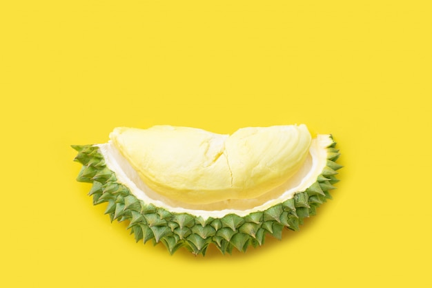 Ripe cut durian on yellow.