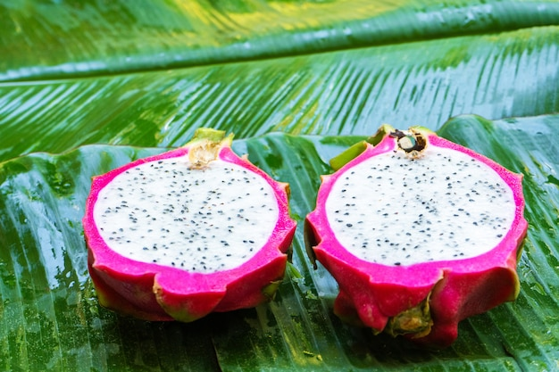 Ripe dragon fruit on a wet green leaf. vitamins, fruits, healthy foods