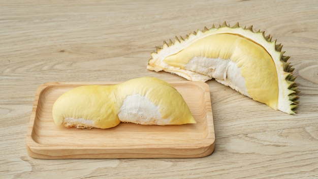 Ripe durian fruit on a wooden table.