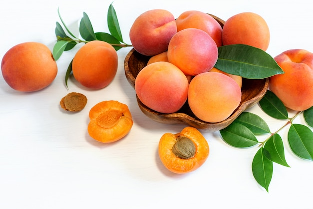 Ripe fresh apricots on the wooden rustic background