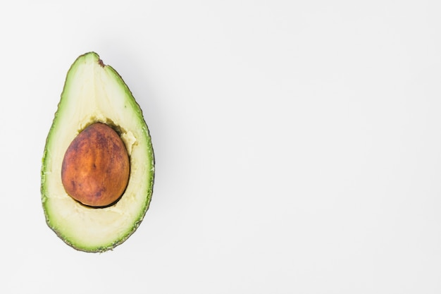 Ripe fresh avocado on white background