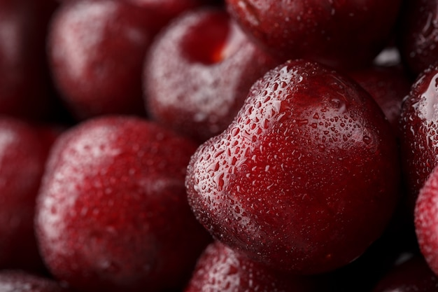 Ripe and fresh berries of a sweet cherry with water drops closeup.