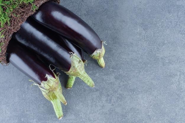 Ripe fresh eggplants on garden vase.
