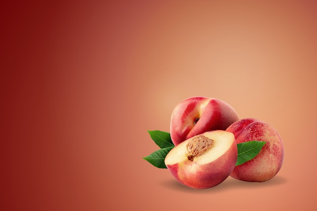 Ripe fresh nectarine fruit isolated on red background.