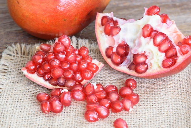 Ripe fresh pomegranate  on a wooden table.