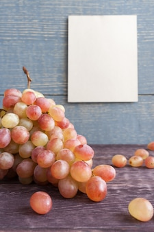 Ripe grapes and paper sheet