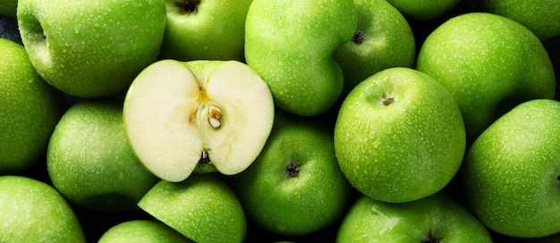 Ripe green apples background, panoramic image