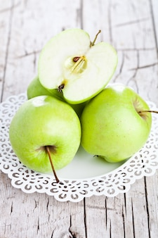 Ripe green apples in a plate